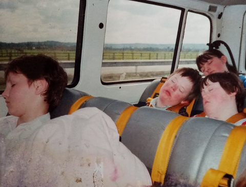 pupils sleeping on a minibus