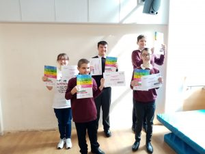students holding their certificates